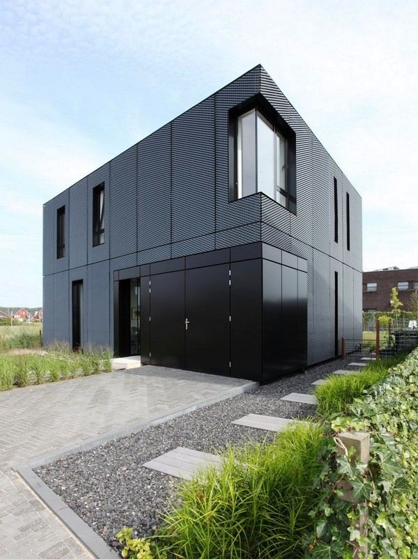 Tips Merenovasi Rumah Menjadi Type Minimalis - Minimalist-home-with-an-eye-catching-expanding-metal-exterior