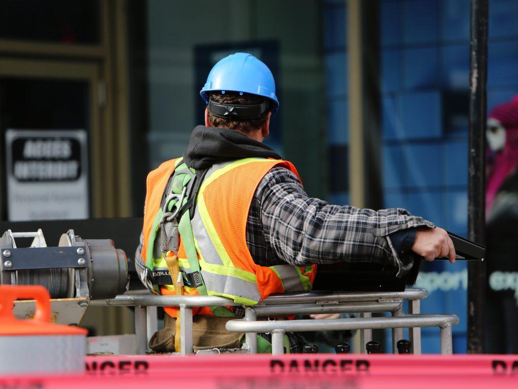 Man wearing hard hat standing
